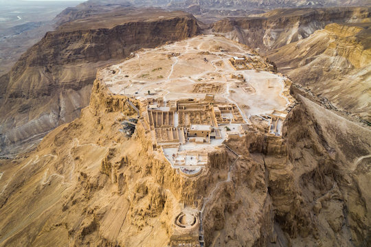 Masada fortress area Southern District of Israel Dead Sea area Southern District of Israel. Ancient Jewish fortress of the Roman Empire on top of a rock in the Judean desert, front view from the air