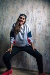 happy beautiful teenage girl dancing hip-hop. close up photo. talent, dance, interest, hobby concept