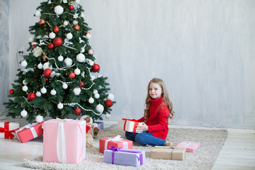 girl with presents new year Christmas tree on a grey background gifts