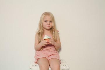 fashion girl eats a candy lollipop cake