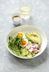 Healthy vegetable salad with avocado,egg and arugula. Plant based, clean eating, vegetarian concepts.