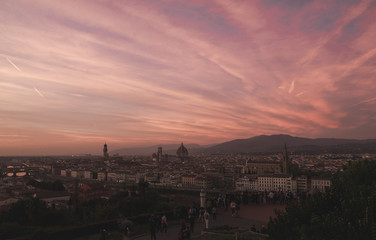 Incredible sunset in Florence, landscape in the red time of day. The most beautiful sunset. Florence, Italy view from the viewport in the unreal sunset with the red sky.