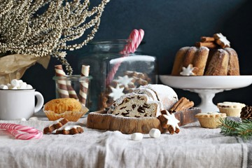 Christmas dessert table with traditional cakes and sweets