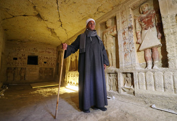 Mustafa Abdo, chief of excavation, stands inside the newly-discovered tomb of 'Wahtye', which dates from the rule of King Neferirkare Kakai, at the Saqqara area near its necropolis, in Giza