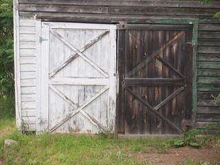 Barn doors one painted one unpainted wood