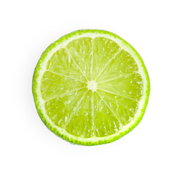 Juicy slice of lime isolated on white background. top view