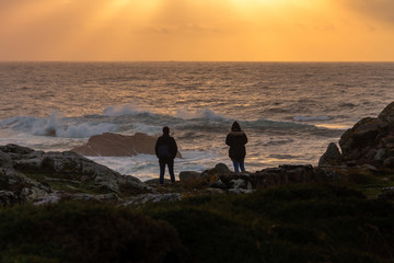 couple on the coast at sunset