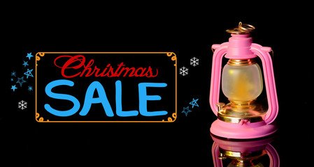 Christmas sale text and Lantern on black background