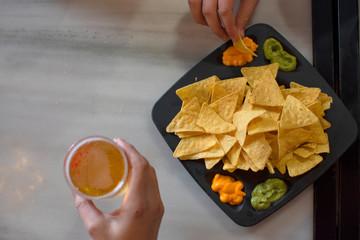 Mexican nachos dish with guacamole sauce