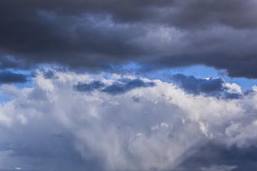 grey stormy clouds on blue sky background