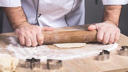 male cook preparing Christmas cookies