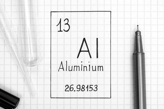 Handwriting chemical element Aluminium Al with black pen, test tube and pipette.