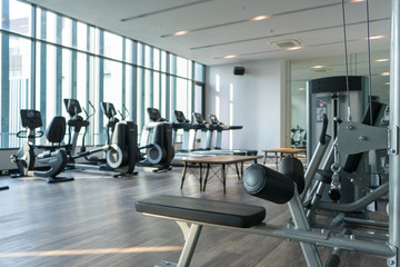 View of fitness room with many exercise equipment installed