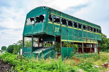 Novi Sad, Serbia May 26, 2018: Rusty Abandoned green Double-Decker Bus