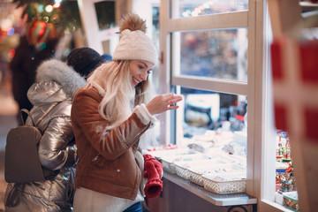 Young woman shopping at New Year Fair