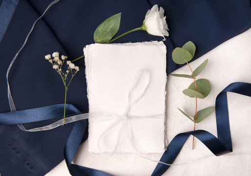 Navy blue wedding invitation mockup with silk ribbons and rough paper