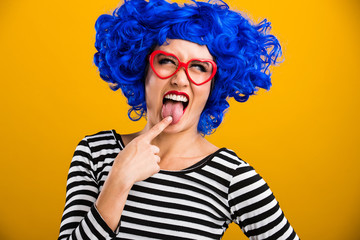 woman with blue wig touching her tongue