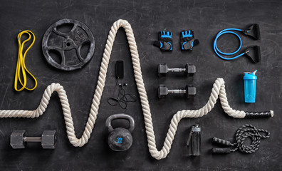 Sports equipment on a black background. Top view. Motivation Fototapete