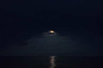 Moon over the sea and moonlit path