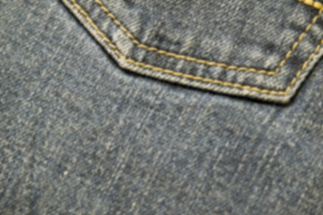 abstraction blurred image of close up texture of back pocket blue denim jeans