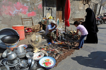 Vendor sells used house appliances and tools at his stall on a street in Hodeidah, Yemen