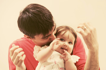 Happy young father and six months old baby girl