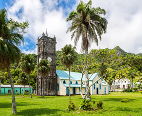 Sacred Heart Roman Catholic Church with a Clock tower. Colourful vibrant old colonial capital of Fiji: Levuka town, Ovalau island, Lomaiviti archipelago, Melanesia, Oceania, South Pacific Ocean