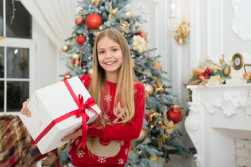 Child enjoy the holiday. Christmas tree and presents. Happy new year. Winter. xmas online shopping. Family holiday. The morning before Xmas. Little girl. Time to celebrate