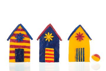 Colorful handmade beach cabins