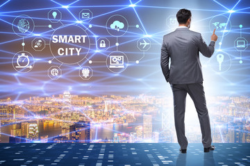 Concept of smart city with businessman pressing buttons