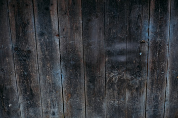 Brown wood wall background texture. Planks of wood damaged by the aging process. Old wooden wall.