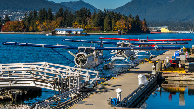 Seaplanes floating at the dock, waiting for tourists. Vancouver, British Columbia, Canada.