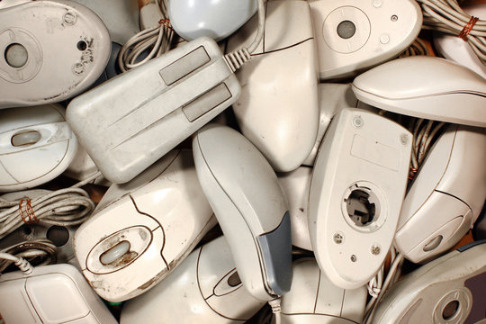 Old dirty and broken computer mice - pile of obsolete electronics waste