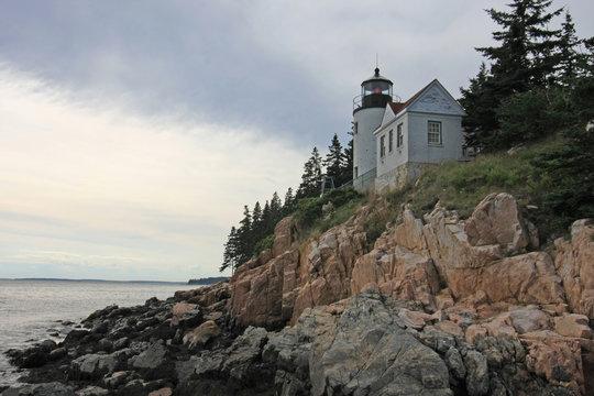 Bass Harbor Head Lighthouse on the rocky coast of Bass Harbor, Maine.