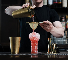 Bartender preparing Tiki Cocktail