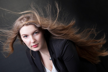 young beautiful girl with long hair in the wind