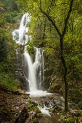 Candal waterfall in the middle of Serra da Lousã, on an autumn day. Lousã, Coimbra district, Portugal.