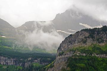Fog lies over the landscape in Glacier National Park.