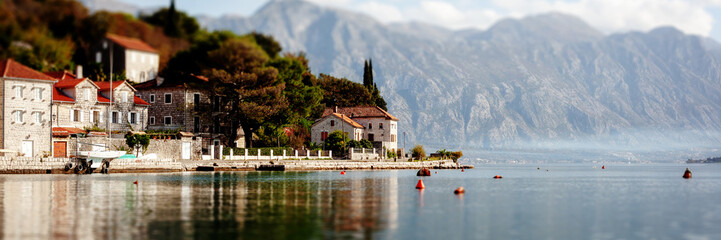 Fototapete - Village Perast on coast of Boka Kotor bay - Montenegro - nature and architecture background, popular travel destination in Europe