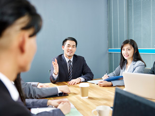 asian corporate people discussing business in meeting