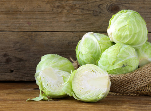 Ripe white cabbage on a wooden table