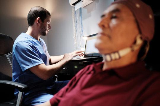 EEG Test on an Elderly Man at Hospital Laboratory