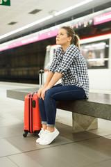 Girl sitting at metro station
