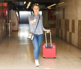 Woman traveler walking in metro