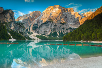 Wall Mural - Fantastic wooden boats on the alpine lake, Dolomites, Italy