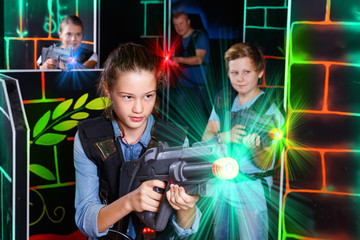 Portrait of teenager girl with laser gun having fun with her fam