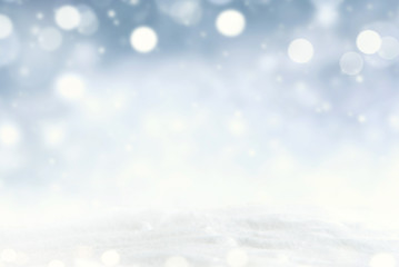 Snowflakes and snowfall on a cold blue winter background.