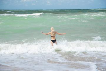 girl in sea surf