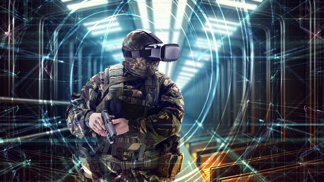 Soldier in virtual reality glasses. Military concept of the future.