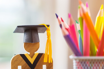 Back to School Concept, People Sign wood with Graduation celebrating cap blur pencil box, show...